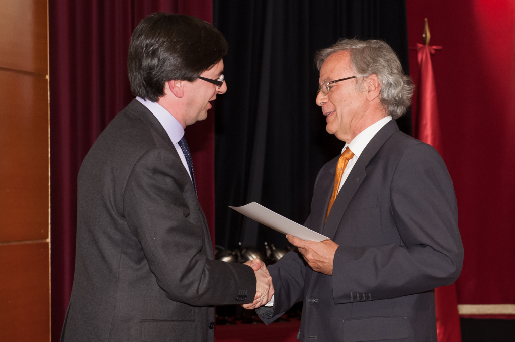 Receiving the 2013 award of research excellence from the President of our University